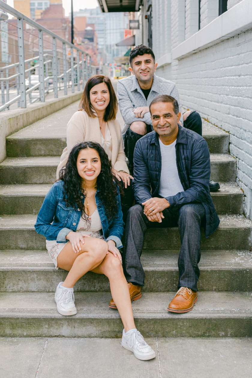 Family portrait of four in urban park in Portland, Oregon's Pearl District