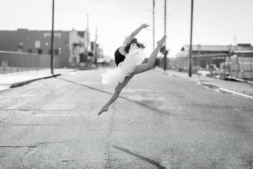Black and white ballet portrait of female dancer on streets of Old Town Eureka, CA