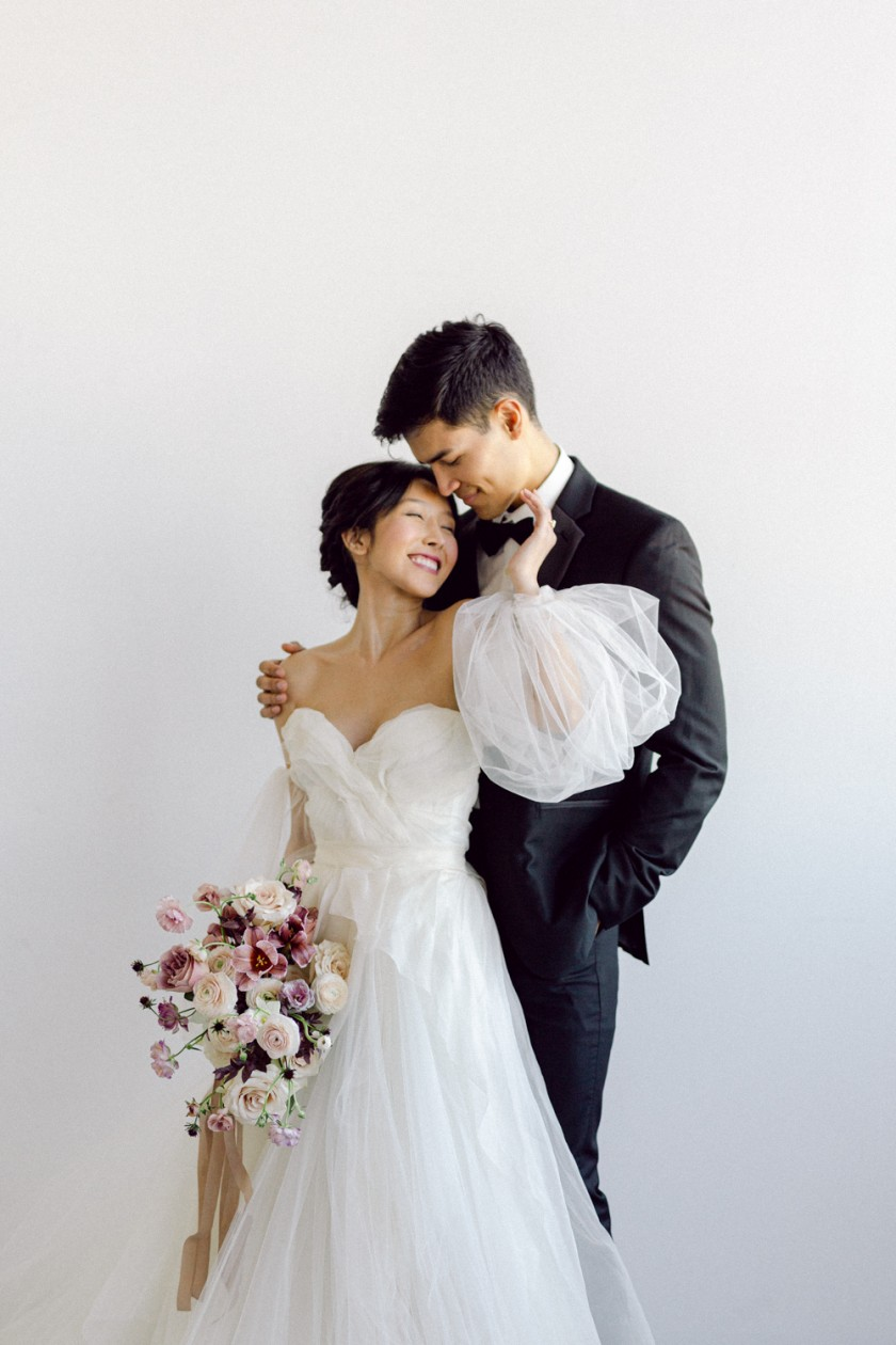 Beautiful bride and groom wedding portrait in natural light loft in San Francisco, CA